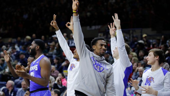 Memphis guard Jeremiah Martin (3) reacts after the Tigers make a 3-pointer against Connecticut on Sunday.