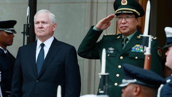 Defense Secretary Robert Gates and Gen. Xu Caihou of