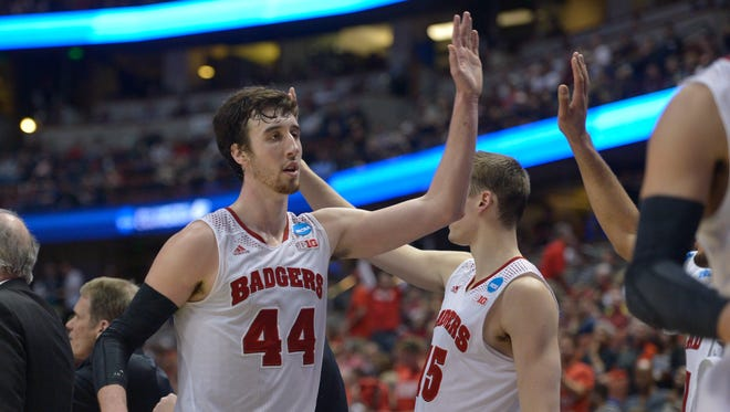 Wisconsin Badgers forward Frank Kaminsky (44) celebrates during the second half in the semifinals of the west regional of the 2014 NCAA Mens Basketball Championship tournament against the Baylor Bears at Honda Center. The Badgers defeated the Bears 69-52.