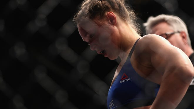 LAS VEGAS, NV - DECEMBER 30: Ronda Rousey reacts to her loss to Amanda Nunes in their UFC women's bantamweight championship bout during the UFC 207 event on December 30, 2016 in Las Vegas, Nevada.  (Photo by Christian Petersen/Getty Images) ORG XMIT: 687715233 ORIG FILE ID: 630706386