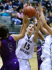 Piedra Vista's Dani Russo fights for the ball against Miyamura on Saturday at the Jerry A. Conner Fieldhouse.