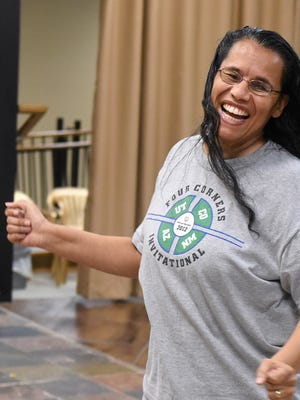 Laura Sowells rehearses on Tuesday at The Force 2.0 dance studio in Farmington. The studio is offering a dance class for Special Olympics athletes that will culminate in a performance at a Farmington High School basketball game.