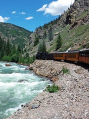 The Durango & Silverton Narrow Gauge Railroad offers passengers spectacular views of the Animas River and the San Juan Mountains.