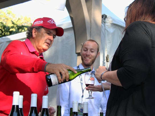 Champions Tour member David Frost gives samples of
