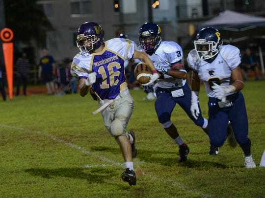 George Washington's Kenji McCarthy (16) runs the ball against the Guam High Panthers during their Interscholastic Football League playoff game at George Washington High School Field in Mangilao on Oct. 22.