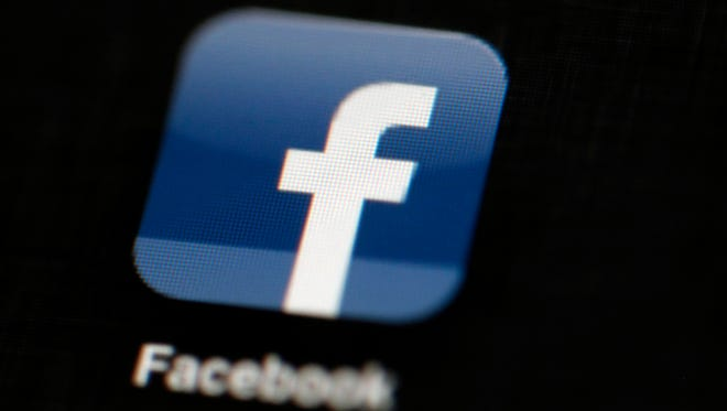 In this May 16, 2012, file photo, the Facebook logo is displayed on an iPad in Philadelphia.