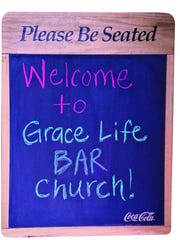 Grace Life has started a new church location at Rock Bottom American Pub and call it Grace Life Bar Church as seen on Sunday, July 20, 2014.