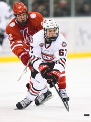 St. Cloud State's Daniel Tedesco, 67, is chase by Willie