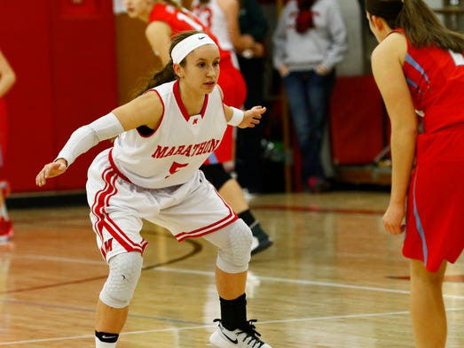 Marathon's Alysha Stieber(5), left, blocks Newman's