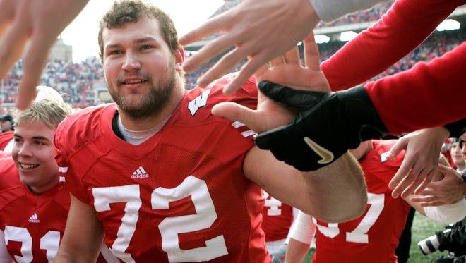 University of Wisconsin senior Joe Thomas celebrates a 35-3 win over Buffalo in November 2006.