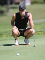 Surveying the green before a putt is Plymouth's Katie Chipman. She verbally committed to play women's golf at Grand Valley State University.