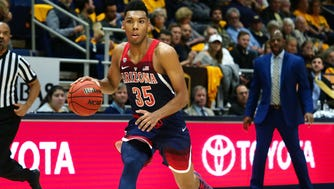 Arizona guard Allonzo Trier dribbles up the court against California.