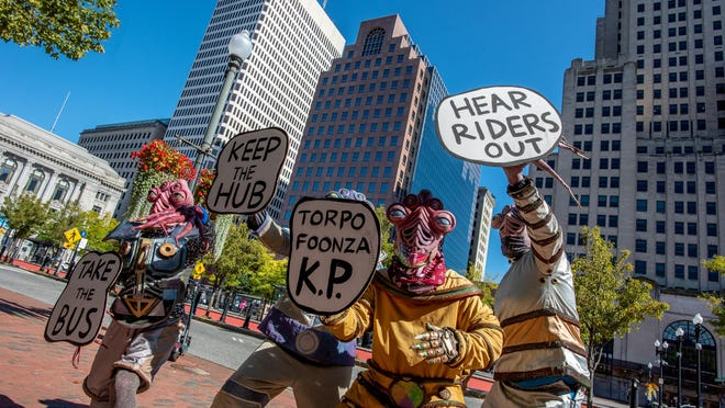 Members of downtown's Big Nazo Lab lend some support at Saturday's rally by transit riders who oppose the plan to do away with the Kennedy Plaza bus hub.