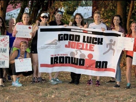Neighbors, friends and workout partners of Joelle Kenney of Cinnaminson made her a sign to wish her well at the Ironman Maryland she competed in on October 7. Kenney is a mother and wife who decided to compete in triathlons a few months ago. She is a former two-sport athlete at Rutgers University-Camden and a Moorestown High graduate.