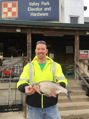 Riley Nolan broke the state record by gigging a 2-pound, 6-ounce gizzard shad on the Big River.