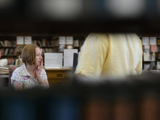Reference librarian Andrea Stepanik helps a patron