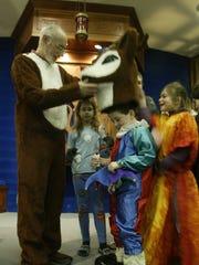 In this 2005 file photo, Rabbi Jeff Portman lets Adam
