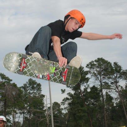 Matt Call flies over a rail during the Goofy vs Regular
