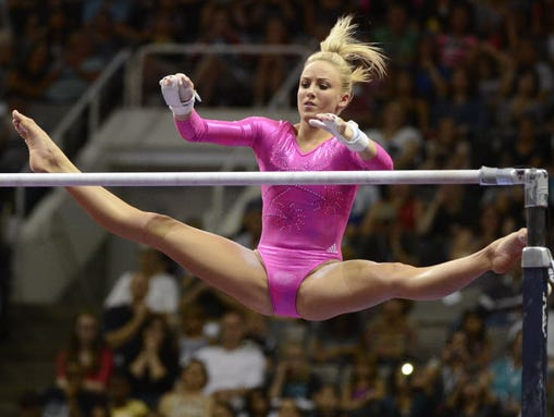 Nastia Liukin performs on the uneven bars during the