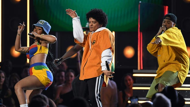 Bruno Mars (center) performs with Cardi B (left) at the 60th  Grammy Awards show on January 28, 2018, in New York.
