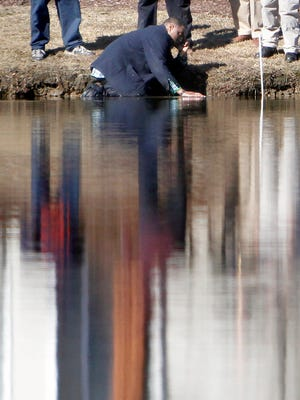 Kneeling in the pond his son's body had been pulled from minutes earlier, Andre Morrison gently strokes the top of the water in the Hidden Lakes neighborhood of Little River on Friday, Dec. 26, 2014. Four-year-old Jayden Morrison had been reported missing from the Hidden Lakes home on Christmas Eve. Hundreds of law enforcement officials and volunteers searched the area until his body was found yards from the home in a retention pond. The cause of death is ruled drowning, according to the Horry County Police. The Morrisons are from Greenburgh and were spending the holidays on the Grand Strand in their second home inside the Little River neighborhood.