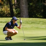 Senior golfer Emily Barker of Lakewood sizes up the green October 7, 2015 during the Division 3 regional golf championship at Centennial Acres in Sunfield.  She shot a 73 on the course.  [MATTHEW DAE SMITH   for the Lansing State Journal]