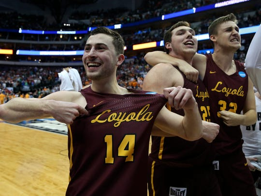 Loyola Ramblers guard Ben Richardson, left, Cameron Krutwig, center, and Carson Shanks react after the victory against the Tennessee Volunteers in the second round of the 2018 NCAA Tournament at American Airlines Center on on March 17, 2018.