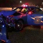 MSP officer crashes car chasing speeder on I-75
