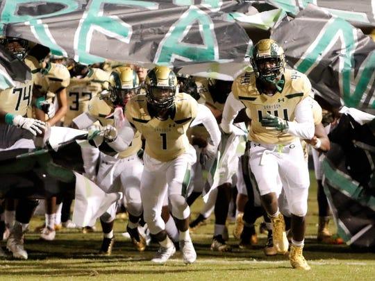 Grayson (Ga.) football players run onto field. (Photo: Magic Moment Photography)