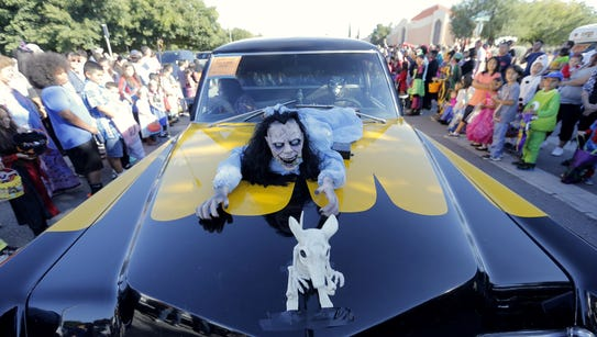 Thousands of El Pasoans lined the streets in costume