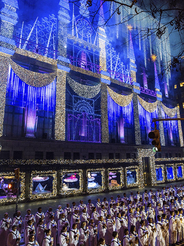Holiday window displays illuminate New York's streets