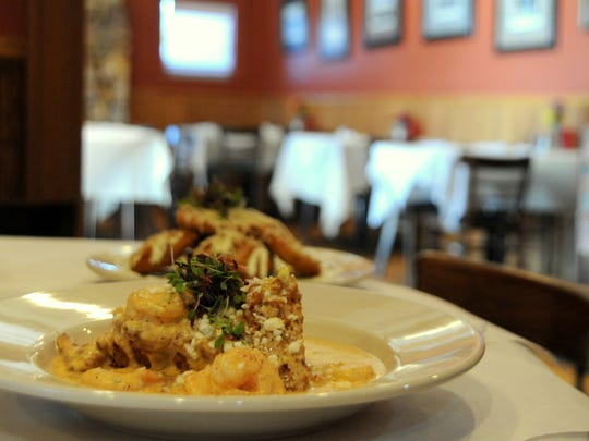 Shrimp and Grits and Fried Green Tomatoes are examples of some Southern dishes with a new flare offered at the Black Mountain Bistro.