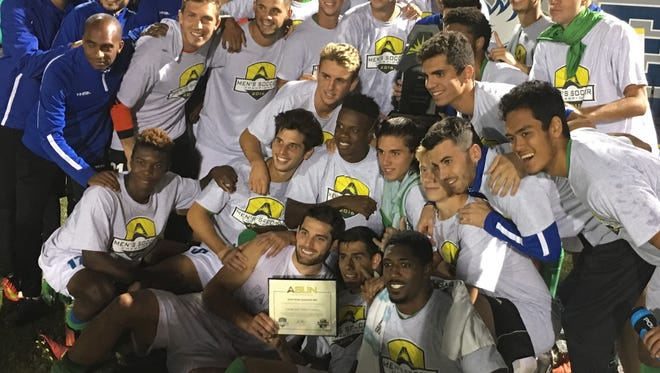 The FGCU men's soccer team celebrates its 3-2 defeat of Jacksonville in the ASUN tournament final Saturday, Nov. 12 at FGCU to reach the NCAA tournament.