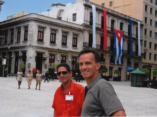 Dr. Fernando Riveron, right, stands with his tour guide in Cuba during a visit to his native country in 2007. Riveron return to Cuba in 2011