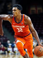 Clemson's Donte Grantham drives for the basket during