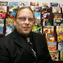 Clint Thomas is seen at his comics store in 2008. The retailer and perennial candidate died Saturday.