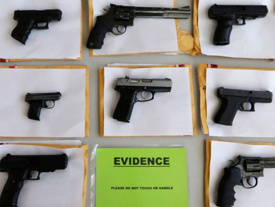 Police display nearly 3,400 confiscated illegal firearms