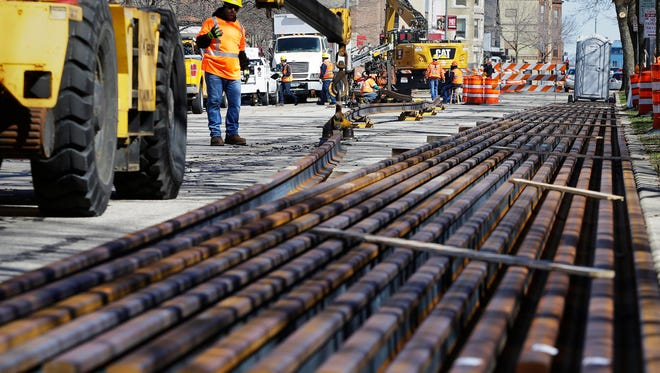 Welded pieces of rail are positioned on Milwaukee Ave. between State St. and Juneau Ave. after a streetcar steel welding demonstration  for Mayor Tom  Barrett and students from Bradley Tech High School.