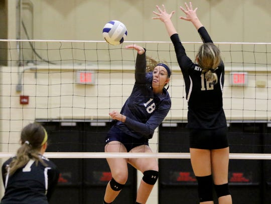 Anna Morris of IHA spikes the ball versus River Dell in the girls volleyball State Tournament of Champions at William Paterson University on Sunday, November 18, 2017.