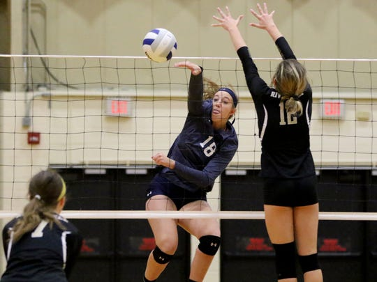 Anna Morris of IHA moves the ball over the net on Sunday.  IHA defeated River Dell in girls volleyball in the Girls Volleyball State Tournament of Champions at William Paterson University, Sunday, November 18, 2017.