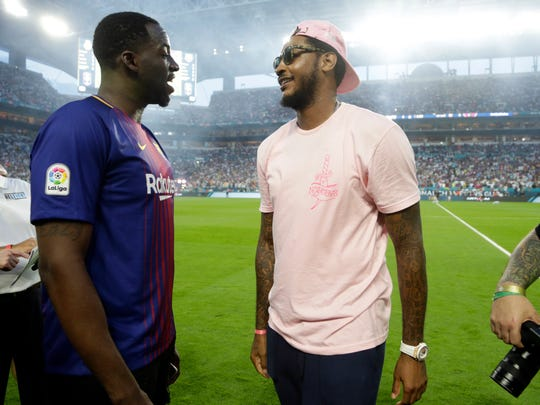 Golden State Warriors' Draymond Green, left, and Carmelo Anthony, right, talks on the field before an International Champions Cup soccer match between Barcelona and Real Madrid, Saturday, July 29, 2017, in Miami Gardens, Fla.