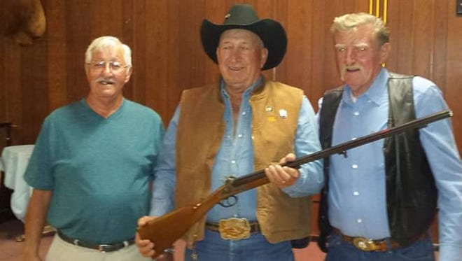 From left, Lonny Curry, chairman of the Veterans Leather Program for the New Mexico Elks Association's Northwest District; Alfred Saavedra, a hunter from San Rafael; and Richard Honneffer, chairman of the Veterans Leather Program for the New Mexico Elks Association, stand for a photo. Saavedra won a double-barrel black powder shotgun in a raffle at the New Mexico Elks Association's state convention.