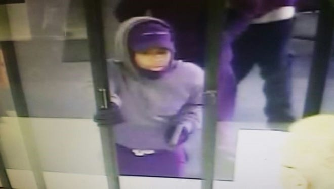 Police released these images of one of three men accused of robbing Marion Prescription off East Center Street Tuesday morning, stealing an undisclosed amount of drugs.