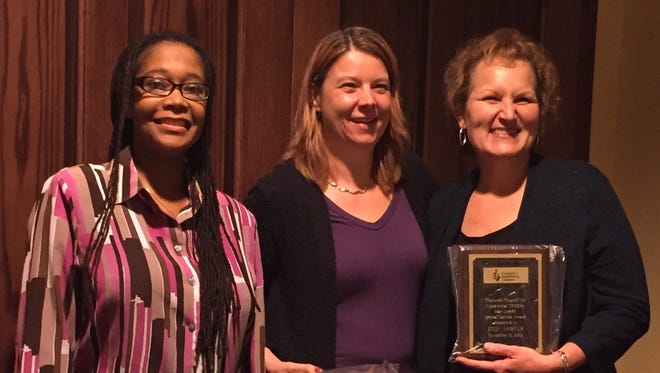 Sevastopol School District's Jody Arbter, right, accepts the May Lemke Special Service Award from Wisconsin Council for Exceptional Children representatives.  Also pictured are Ozalle Toms, left, president-elect of the WCEC; and current president Lana Collet Klingenberg.
