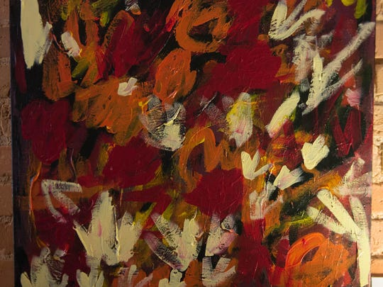 """""""Fiery Bouquet,"""" priced at $650, is one of Lillian Davidson's paintings on display through October at Brownstone Coffee House."""