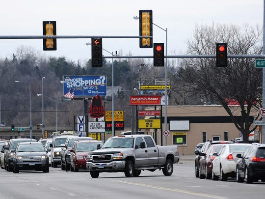 The intersection of 41st Street and Minnesota Avenue on Wednesday, March 18, 2015, in Sioux Falls, S.D. 39 crashes, 6 injuries, 1 fatality since Jan. 2013. City traffic engineers have known for years that the traffic signals at this intersection were difficult for some drivers to see. The lights were designed to only be visible from certain lanes and angles. Crews changed the intersection lights last week to make them easier to see.