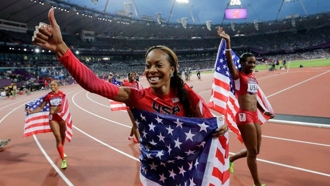 Deedee Trotter, right, Sanya Richards-Ross, front center, and Allyson Felix, back left, celebrate winning gold in the women's 4x400-meter relay final during the athletics in the Olympic Stadium at the Summer Olympics in London. Reigning Olympic 400-meter champion Richards-Ross is retiring after the 2016 Rio de Janeiro Olympics. (AP Photo/David J. Phillip, File)