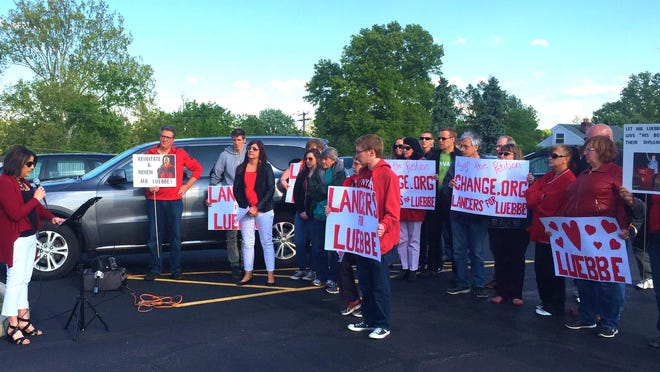 A group gathered for a short prayer vigil on Pentecost Sunday in support of ousted principal Tom Luebbe and to pray for answers.