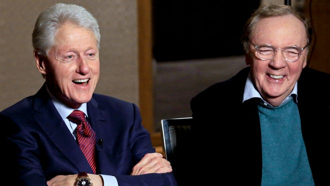 """In this May 21 photo, former President Bill Clinton (left) and author James Patterson speak during an interview about their new novel, """"The President is Missing,"""" in New York."""