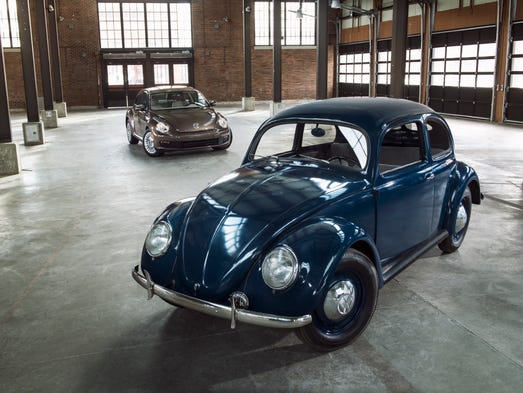 "The 2014 Beetle (background) still shares plenty of genes with the original generation, which landed on U.S. soil in 1949. ""The Beetle has become part of the cultural fabric in America and we are proud that its rich heritage continues to live with fans around the States,"" said Michael Horn, president and CEO of Volkswagen Group of America."